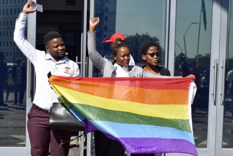 Image: Activists celebrate outside the High Court in Gaborone after the court rejected sections of the penal code that punish gay sex in Botswana on June 11, 2019.