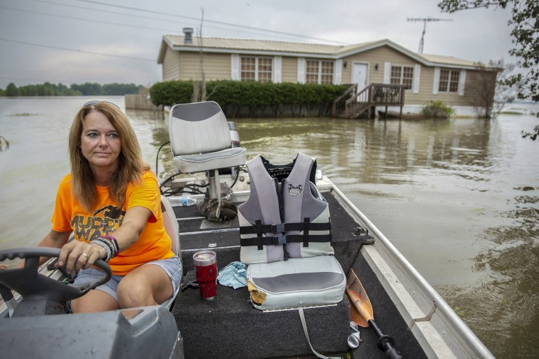 Stormy Deere navigates her boat to dry land near Redwood, Mississippi on June 4, 2019. Deere has lived at her home with her husband Jimmy for 12 years. She has had to use her fishing boat to get to and from her home since early March.