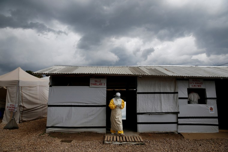 Image: FILE PHOTO: A health worker wearing Ebola protection gear, leaves the dressing room before entering the Biosecure Emergency Care Unit at the ALIMA Ebola treatment center in Beni