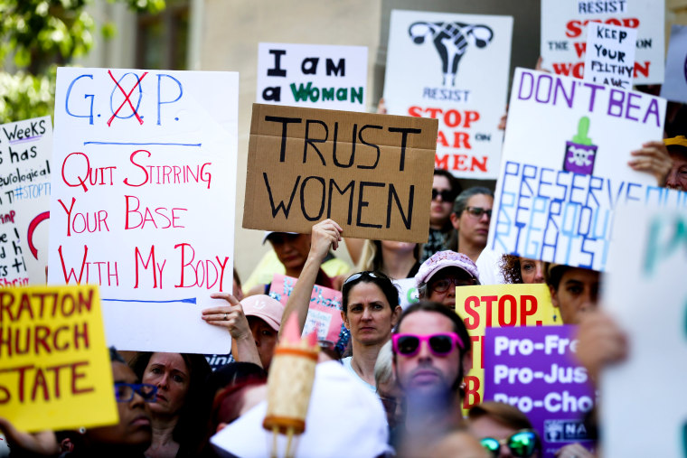 Image: Women hold signs during a protest against an abortion bill at the Georgia State Capitol in Atlanta on May 21, 2019.