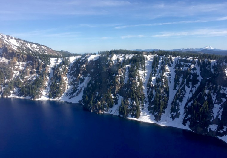 Image: The caldera of Crater Lake National Park in Oregon on June 10, 2019. The U.S. Coast Guard rescued a man who fell into the caldera.