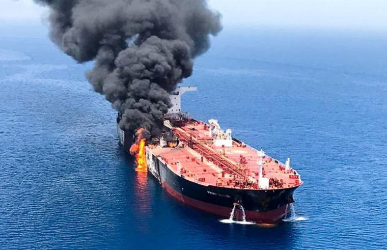 Smoke billows from an oil tanker in the Gulf of Oman on June 13, 2019.