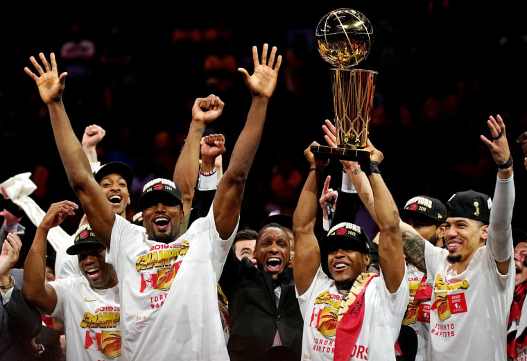 Image: The Toronto Raptors celebrate with the Larry O'Brien Trophy after beating the Golden State Warriors in game six of the 2019 NBA Finals at Oracle Arena.