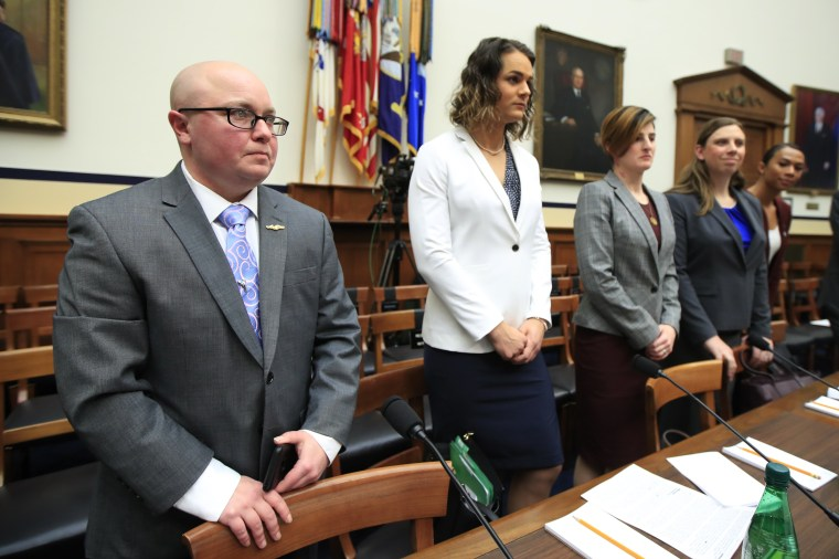 Image: Transgender military members Navy Lt. Cmdr. Blake Dremann, Army Capt. Alivia Stehlik, Army Capt. Jennifer Peace, Army Staff Sgt. Patricia King and Navy Petty Officer Third Class Akira Wyatt, before the start of a House Armed Services Subcommittee h