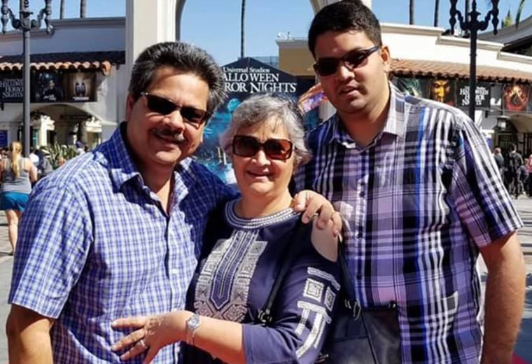 Kenneth French, 32, who was killed in a shooting by an off-duty Los Angeles police officer at a Costco in Corona, California, is shown with his parents, Russell and Paola French, who were injured in the shooting, according to French's cousin, and remained hospitalized Sunday.