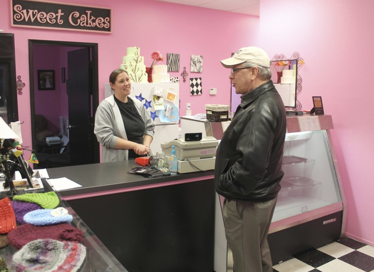 Melissa Klein, co-owner of Sweet Cakes by Melissa, in Gresham, Oregon, speaks with a customer in 2013.