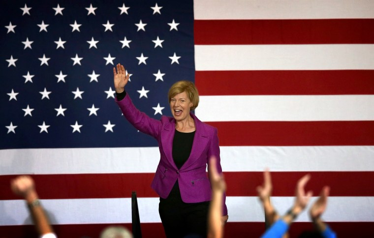 Tammy Baldwin greets supporters at a campaign rally for Barack Obama in Milwaukee, Wisconsin, on Nov. 3, 2012.  In 2012, Baldwin became the first openly LGBT person elected to the United States Senate.