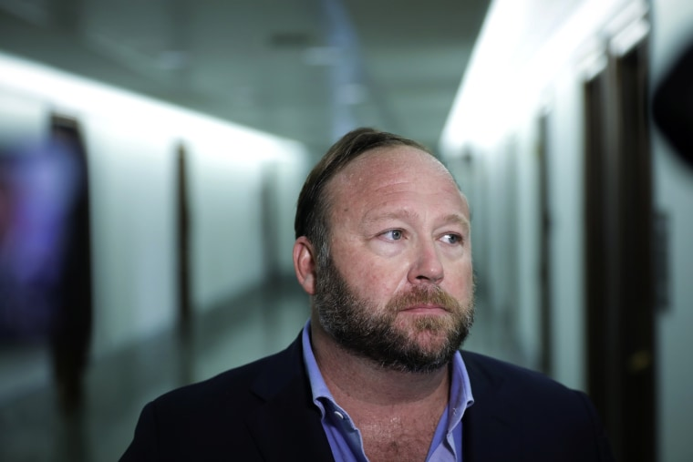 Image: Alex Jones speaks to reporters outside of a Senate Intelligence Committee hearing on Sept. 5, 2018.