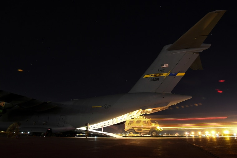 Image: A U.S. Soldier drives a MaxxPro mine-resistant, ambush protected vehicle onto a C-17 Globemaster III assigned to the 816th Expeditionary Airlift Squadron, out of Al Udeid Air Base in Doha