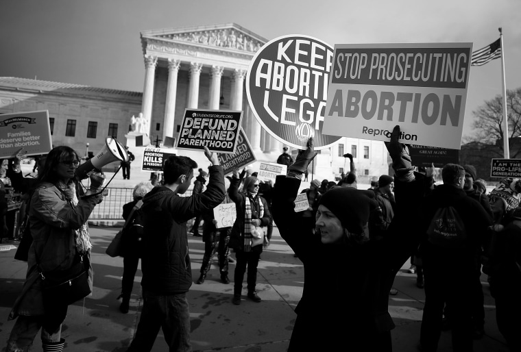 Image: Abortion rights and anti-abortion advocates gather in front of the Supreme Court during the March for Life in Washington on Jan. 18, 2019.
