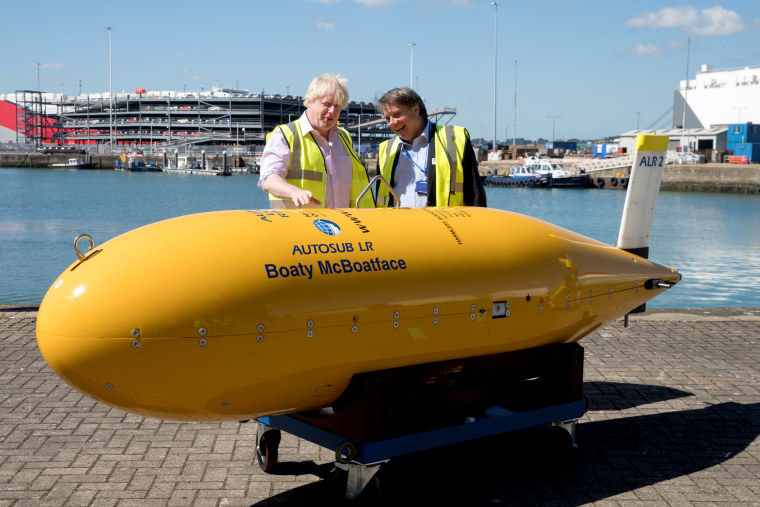 Image: Foreign Secretary Boris Johnson stands with Boaty McBoatface, an autonomous underwater vehicle used for scientific research, in Southampton, England, on June 22, 2018.