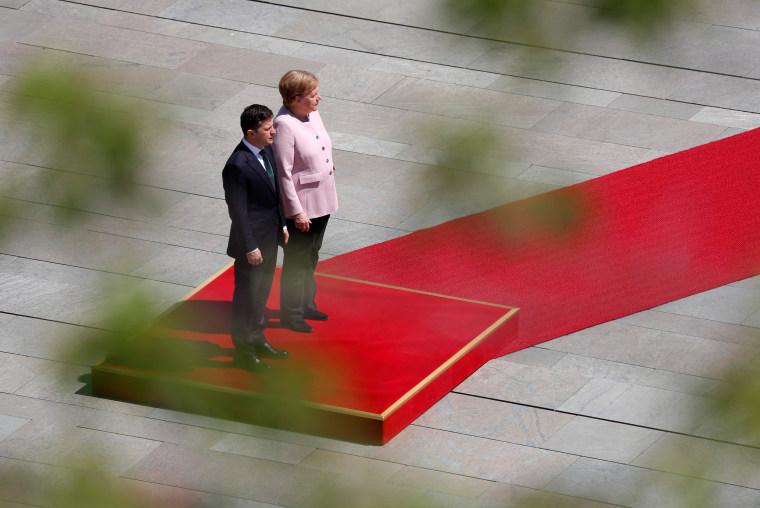 Image result for Merkel shakes
