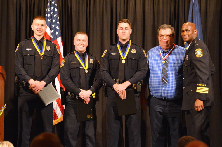 Pizza delivery man Mark Buede and the officers who responded (Officers Corey Sutton, Zakary Ridener and William Phillips) were honored for their efforts at the Police Awards Banquet on June 18, 2019 in Lexington, Kentucky.