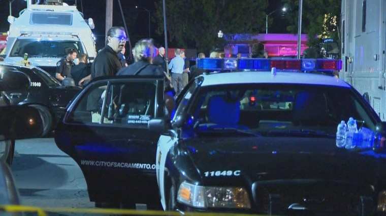 Sacramento police officer shot and killed; standoff with suspect continues