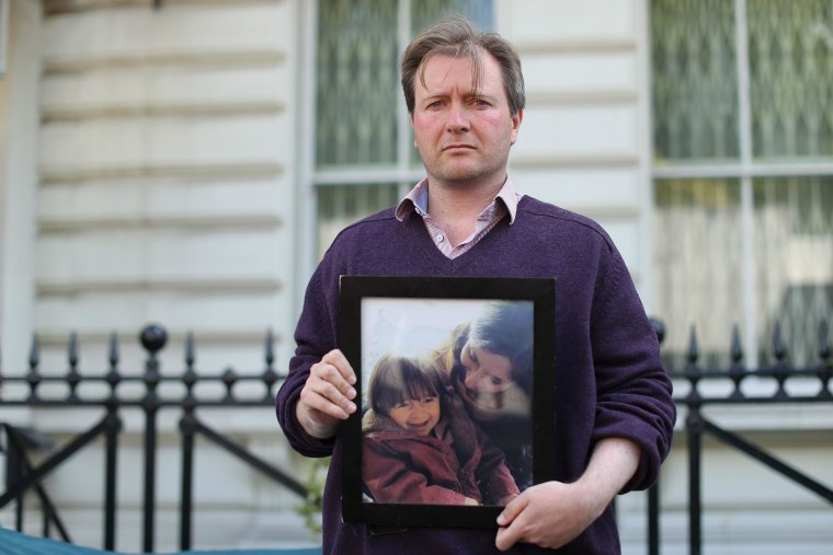 Image: Richard Ratcliffe, husband of British-Iranian woman Nazanin Zaghari-Ratcliffe who is emprisoned in Iran, holds a photograph of his wife and daughter during his hunger strike outside the Iranian embassy