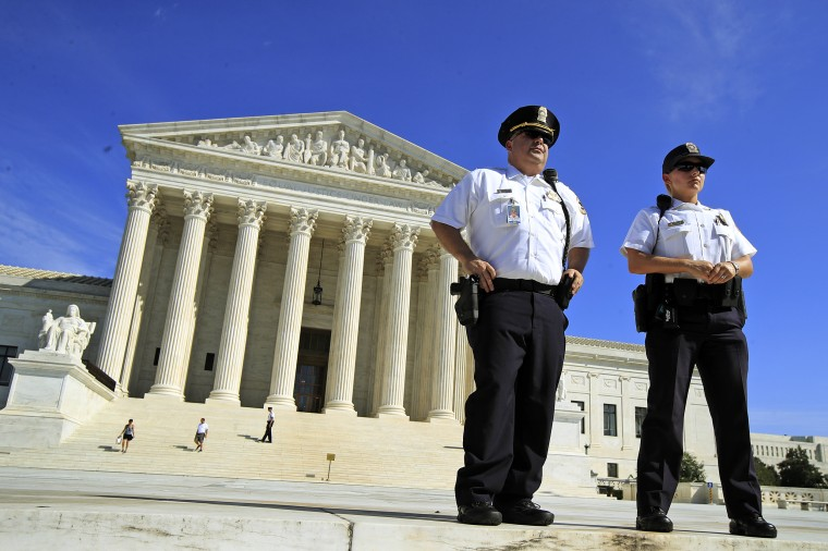 U.S. Supreme Court Police Department officers stand in front of the Supreme Court on Oct. 4, 2018.