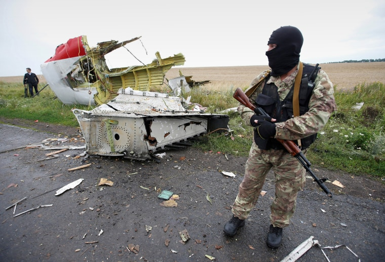 A pro-Russian separatist at the crash site of Malaysia Airlines flight MH17 near the village of Hrabove in the Donetsk region of Ukraine on July 18, 2014.
