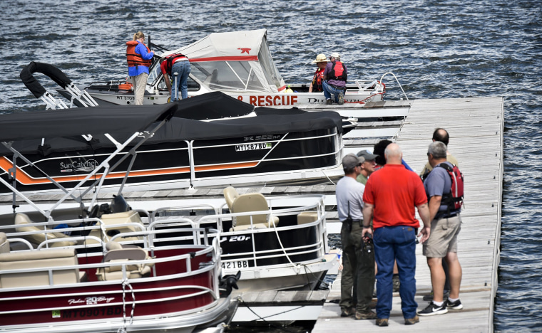 Image: Search and rescue teams stage near Cemetery Island on Canyon Ferry Lake as they search for a missing diver on June 17, 2019.