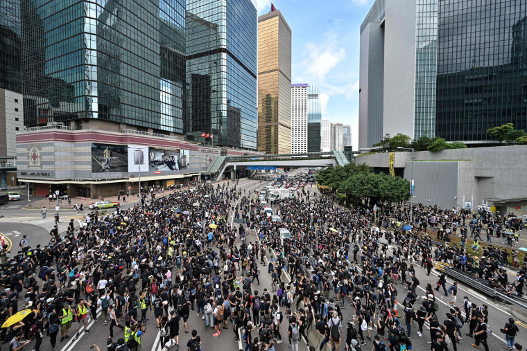Image: Protesters occupy a main road outside the government headquarters in Hong Kong