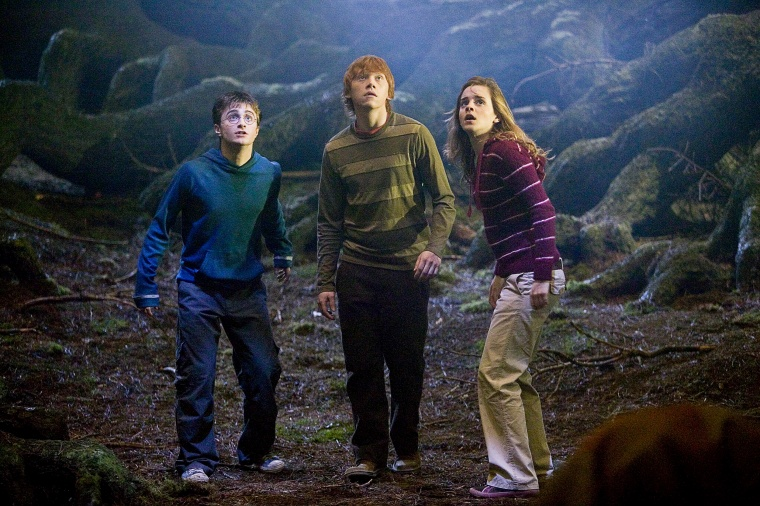 """Image: Daniel Radcliffe, left, Rupert Grint, center, and Emma Watson in a scene from \""""Harry Potter and the Order of the Phoenix.\"""""""