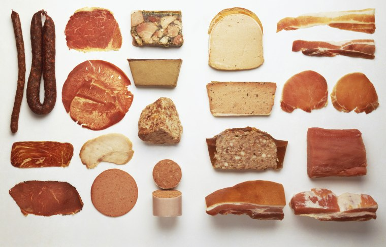 Selection of preserved meats and bacons, close up.