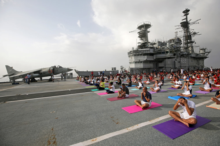 Image: Members of the Indian Navy perform yoga on the flight deck of INS Viraat, an Indian Navy decommissioned aircraft carrier, during International Yoga Day in Mumbai