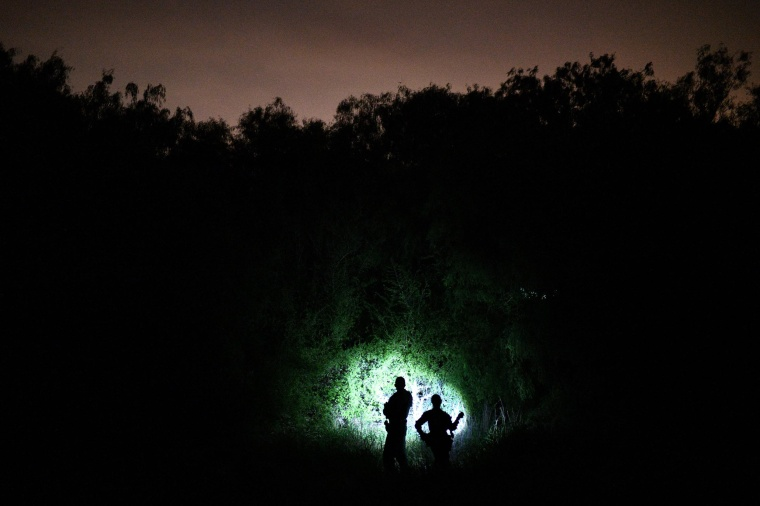 Image: U.S. Border Patrol agents search for undocumented migrants near the Rio Grande near Palmview, Texas.