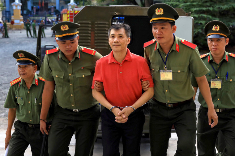 Image: Michael Nguyen is escorted by police to court in Ho Chi Minh City, Vietnam, on June 24, 2019.