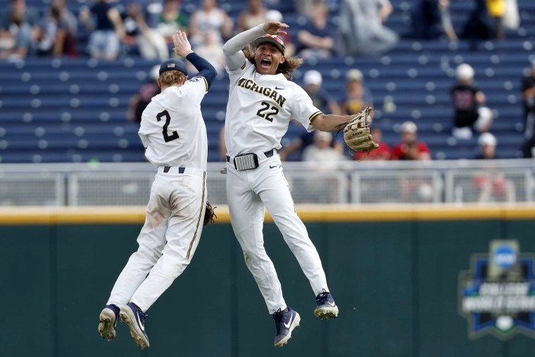 Image: Michigan Wolverines shortstop Jack Blomgren and right fielder Jordan Brewer celebrate after defeating Texas Tech in the College World Series on June 21, 2019.