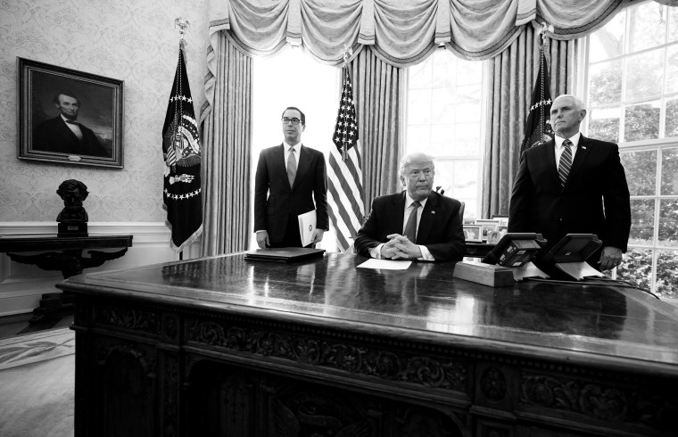 Image: President Donald Trump, Vice President Mike Pence and Treasury Secretary Steve Mnuchin in the Oval Office before signing sanctions against Iran's Supreme Leader on June 24, 2019.