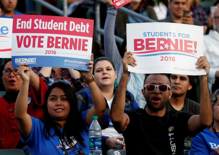 Image: Student supporters hold up signs as they wait for U.S. Democratic presidential candidate Sanders to speak during a rally in Carson