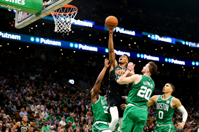 Image: Boston Celtics defenders try to block a shot from Giannis Antetokounmpo, of the Milwaukee Bucks, at TD Garden in Boston on Dec. 21, 2018.