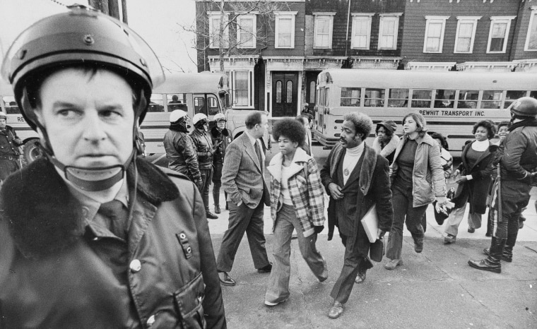 Police were on hand to provide protection to black students as they arrived at South Boston High School on Jan. 8, 1975.