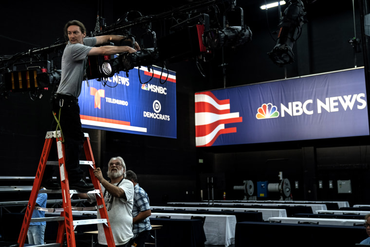 Image: Workers assemble the set before the Democratic presidential primary debates in Miami, Florida, on June 25, 2019.