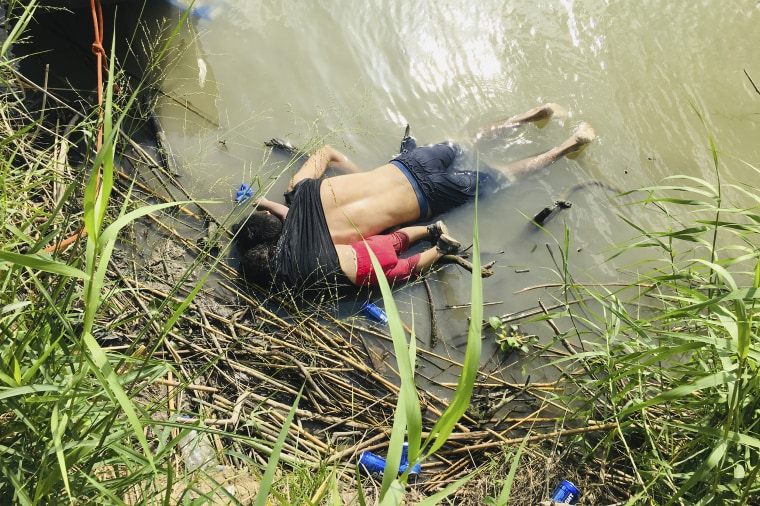 The bodies of Salvadoran migrant Oscar Alberto Martinez Ramirez and his nearly 2-year-old daughter Valeria lie on the bank of the Rio Grande in Matamoros, Mexico on June 24, 2019, after they drowned trying to cross the river to Brownsville, Texas. Martinez' wife, Tania told Mexican authorities she watched her husband and child disappear in the strong current.