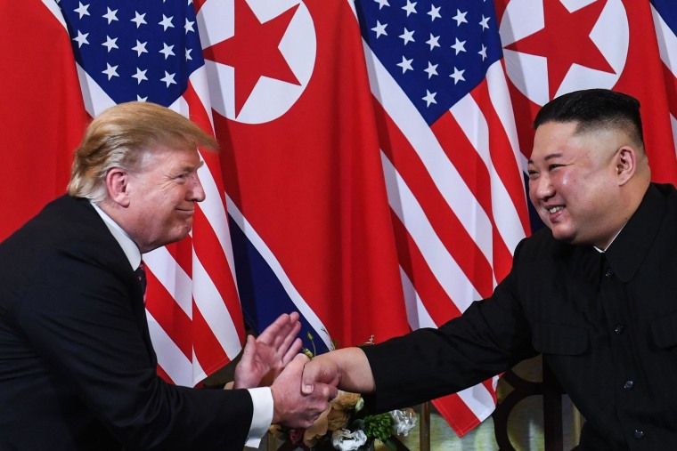 Image: President Donald Trump shakes hands with North Korea's leader Kim Jong Un following a meeting at the Sofitel Legend Metropole hotel in Hanoi