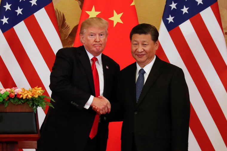 Image: President Donald Trump and China's President Xi Jinping shake hands after making joint statements at the Great Hall of the People in Beijing