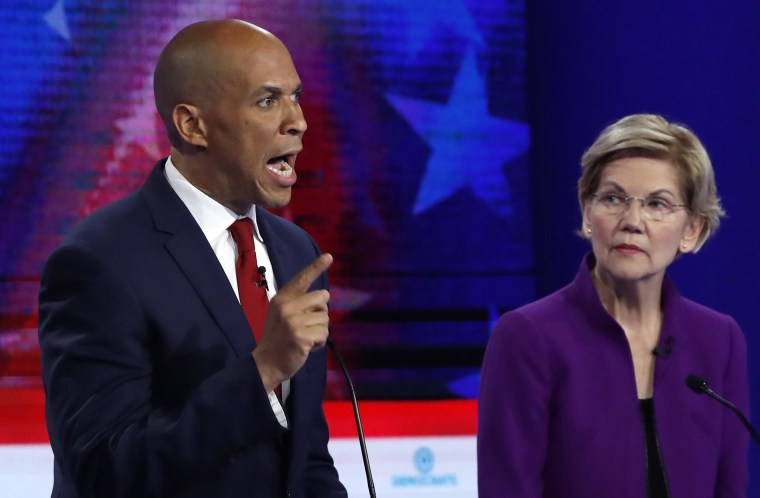 Image: Senator Cory Booker speaks as Senator Elizabeth Warren listens at the first U.S. 2020 presidential election Democratic candidates debate in Miami, Florida
