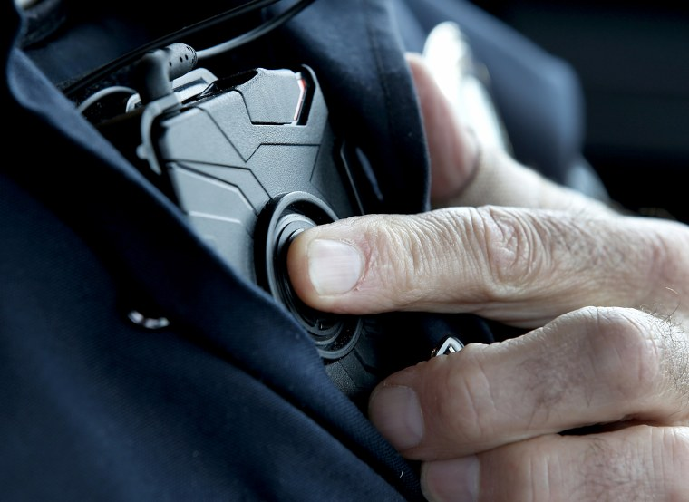 Image: A West Valley City patrol officer starts an Axon body camera in Utah on March 2, 2015.