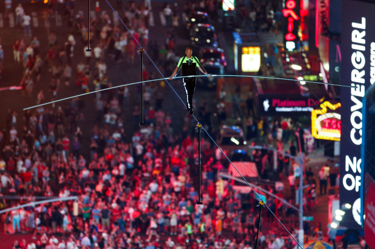 Image: Aerialist Wallenda walks the highwire with his sister Lijana over Times Square in New York