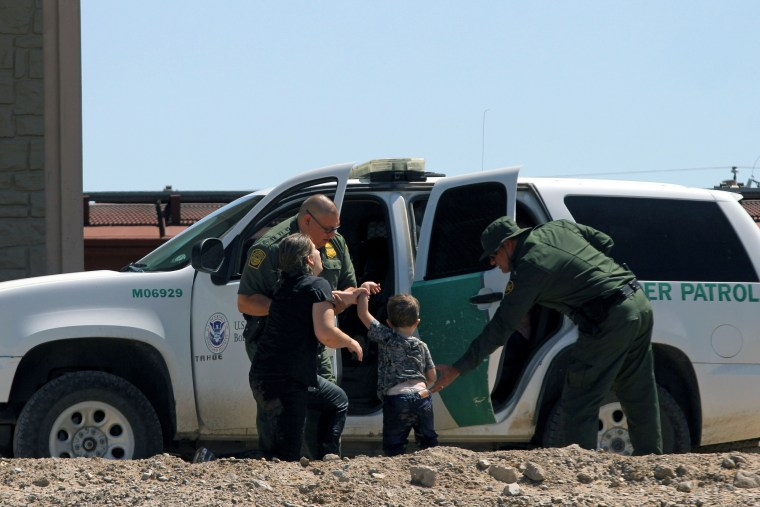 Migrants turn themselves into U.S. Border Patrol agents to claim asylum after crossing the Rio Grande on June 12, 2019.