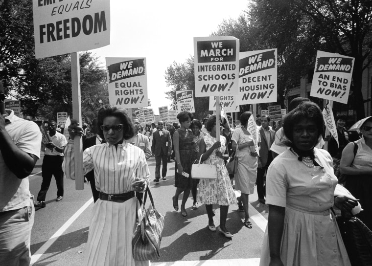 Image: Demonstrators carry signs calling for equal rights and integrated schools in Washington, D.C., on Aug. 28, 1963.