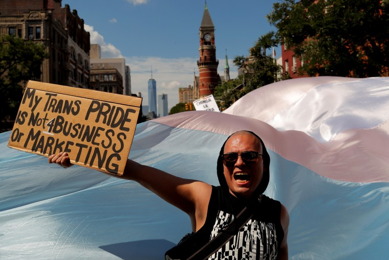 Image: An activist shouts at the Queer Liberation March on June 30.