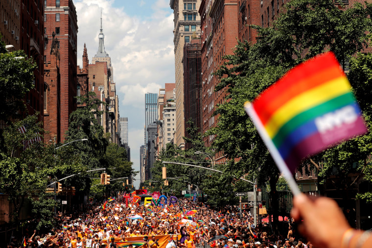 Image: People march down 5th Avenue during the 2019 World Pride NYC and Stonewall 50th LGBTQ Pride Parade in New York