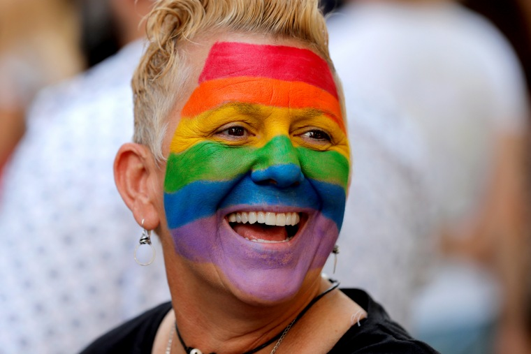 Image: A woman smiles on 2019 World Pride NYC and Stonewall 50th LGBTQ Pride day in New York