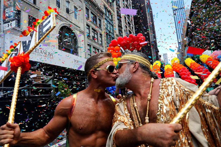 Image: A couple shares a kiss while marching in New York's Pride March on June 30.