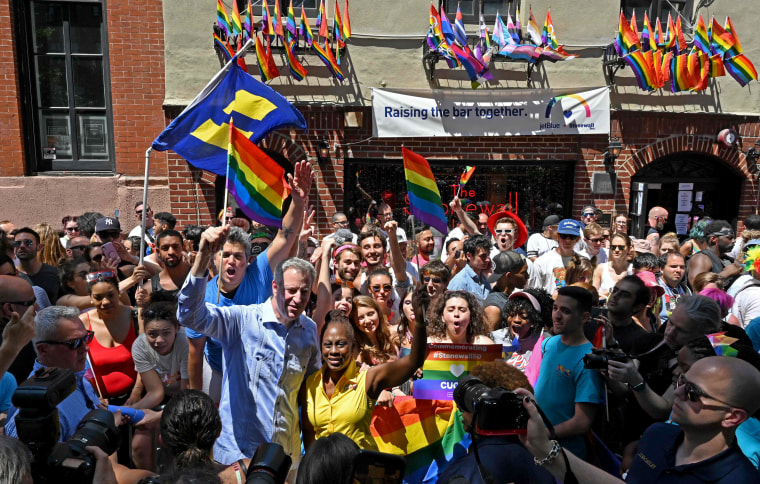 Image: New York Mayor Bill de Blasio waves in front of the Stonewall Inn during New York's Pride celebrations on June 30.