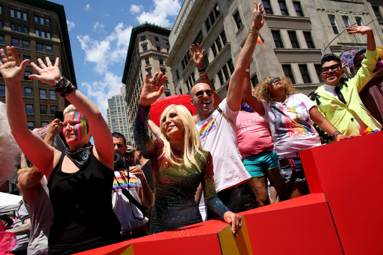 Image: Donatella Versace waves during the New York Pride Parade on June 30.