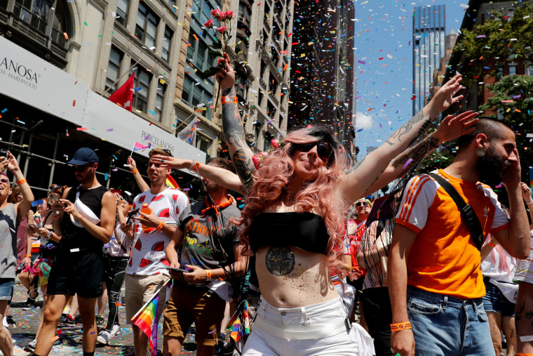 Image: Revelers dance during New York's Pride March on June 30.