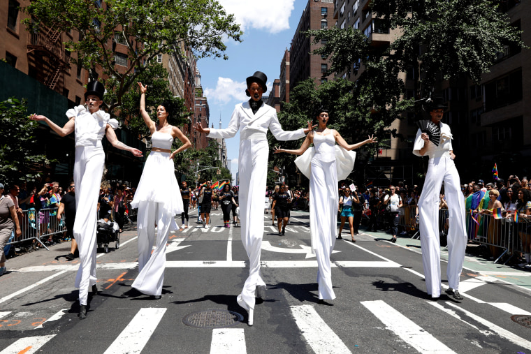 Image: People on stilts during New York's Pride March on June 30.